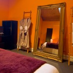 Gallery Suite Bedroom with Bathrobes and Giant Mirror